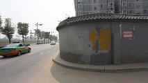 Highway in China partially blocked by a housing complex