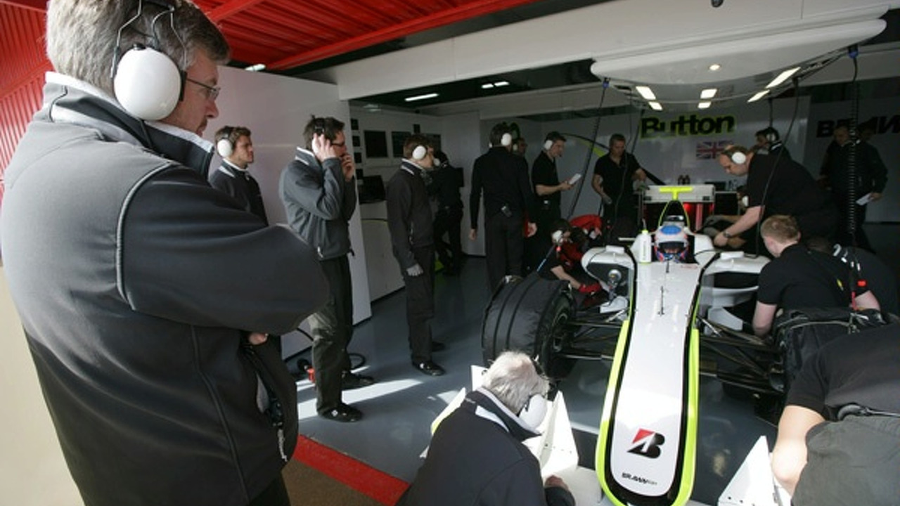 Ross Brawn oversees BGP001 with Jenson Button behind the wheel
