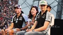 Sergio Perez, Sahara Force India F1 and team mate Nico Hulkenberg, Sahara Force India F1 at the fans stage