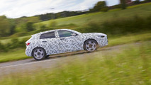 Infiniti teases Q30 with camouflaged prototype; announces Frankfurt debut in September