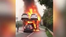 Audacious driver removes sedan from burning transporter
