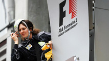 Greenpeace activist Julia F makes protest against race title sponsors Shell at the podium 25.08.2013 Belgian Grand Prix
