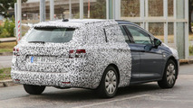 Next generation Opel Astra Sports Tourer spied hiding its more practical rear end