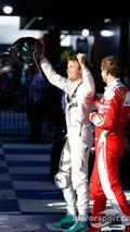 Race winner Nico Rosberg, Mercedes AMG F1 celebrates in parc ferme with third placed Sebastian Vettel, Ferrari