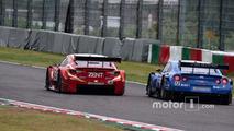 #38 Team Zent Cerumo Lexus RC F: Yuji Tachikawa, Hiroaki Ishiura and #12 Team Impul Nissan GT-R Nismo GT3: Hironobu Yasuda, Joao Paulo de Oliveira