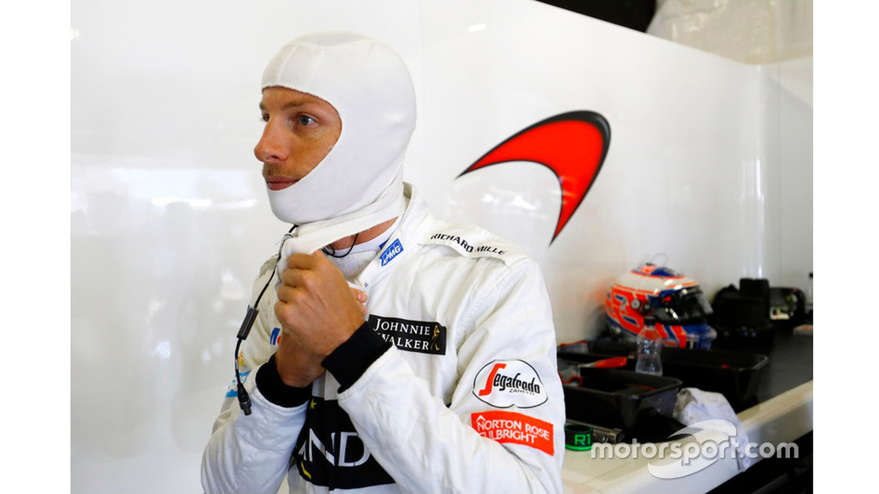 Jenson Button, McLaren MP4-31 adjusts his balaclava in the garage