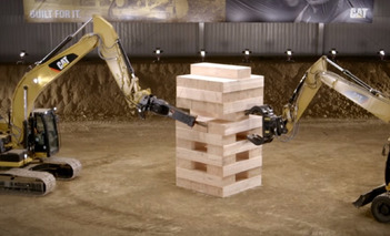 Watch a Game of Jenga Using Caterpillar Construction Vehicles