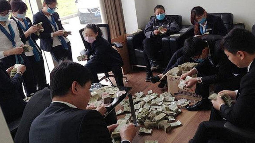 Chinese woman buys new BMW with small change, employees count for six hours