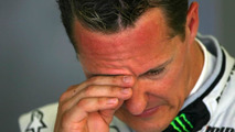 Ecclestone doubts Schumacher will stay in 2011