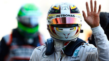 Lewis Hamilton, Mercedes AMG F1, waves to the fans after taking Pole Position