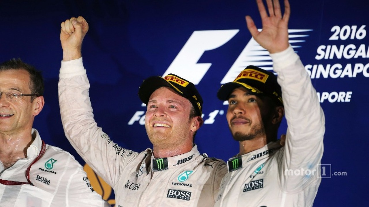 (L to R)- Race winner Nico Rosberg, Mercedes AMG F1 celebrates on the podium with third placed team mate Lewis Hamilton, Mercedes AMG F1