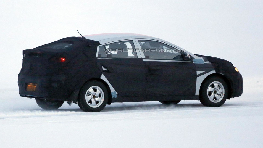 Hyundai Prius competitor spied wearing a production body