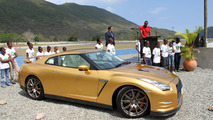 Usain Bolt takes delivery of the Nissan GT-R Spec Bolt