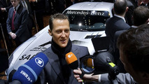 Michael Schumacher talking to the media next to the Mercedes SLS AMG F1 Safety Car at Geneva Motor Show