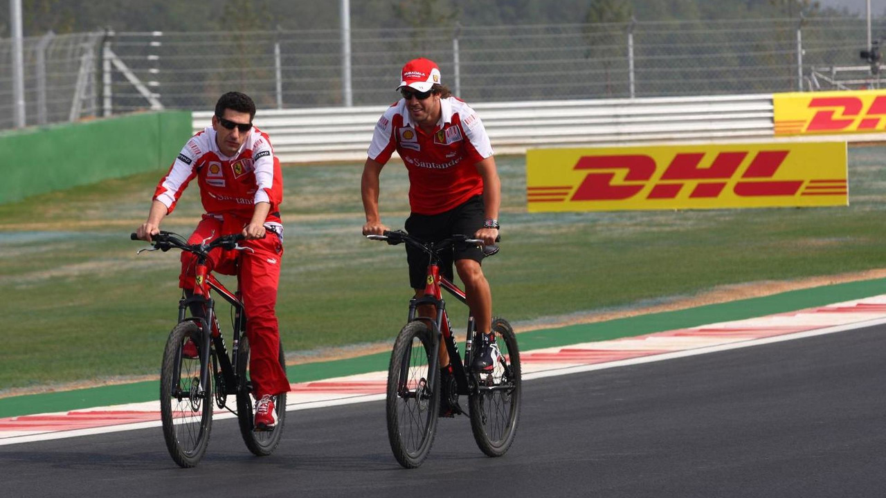 Fernando Alonso (ESP) riding on his bike / XPB
