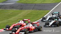 Sebastian Vettel, Ferrari SF16-H and team mate Kimi Raikkonen, Ferrari SF16-H battle for position