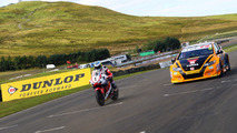 Isle of Man TT legend and BTCC champion swap machines for a race