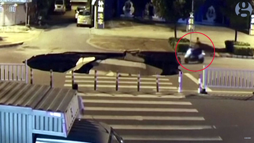 Watch This Scooter Driver Casually Ride Into A Massive Sinkhole