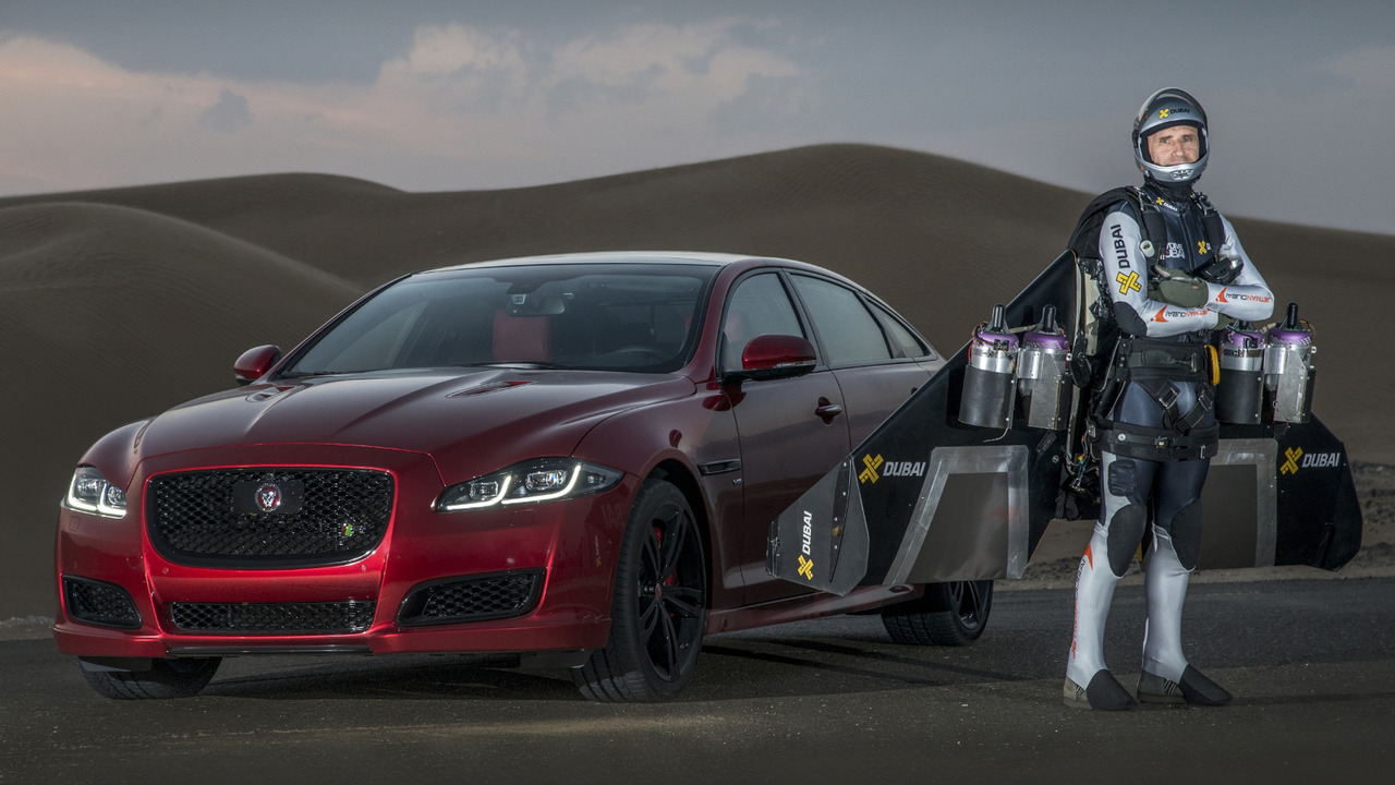 Jaguar XJR races man on jet pack