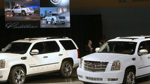 Cadillac Escalade Hybrid (L) and Platinum (R)