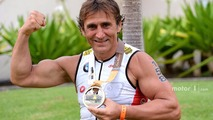 Alex Zanardi celebrates after winning his class in the Hawaii Ironman triathlon