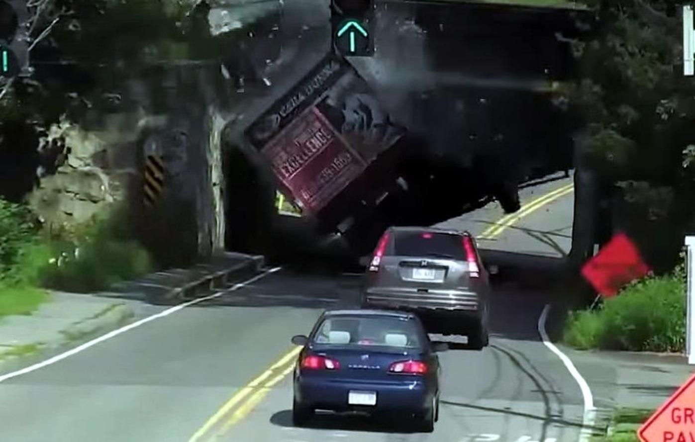 Watch as a Truck Slams into a Low Train Bridge in MA
