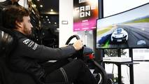 Fernando Alonso, McLaren, has a run in a driving simulator as part of the Worlds Fastest Gamer project being run by McLaren