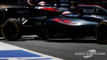 Jenson Button, McLaren MP4-31 and Fernando Alonso, McLaren MP4-31 in the pit lane