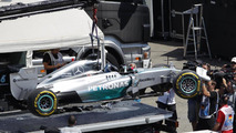The Mercedes AMG F1 W05 of Lewis Hamilton (GBR) Mercedes AMG F1 is is recovered back to the pits on the back of a truck after he crashed out of qualifying, 19.07.2014, German Grand Prix, Hockenheim / XPB