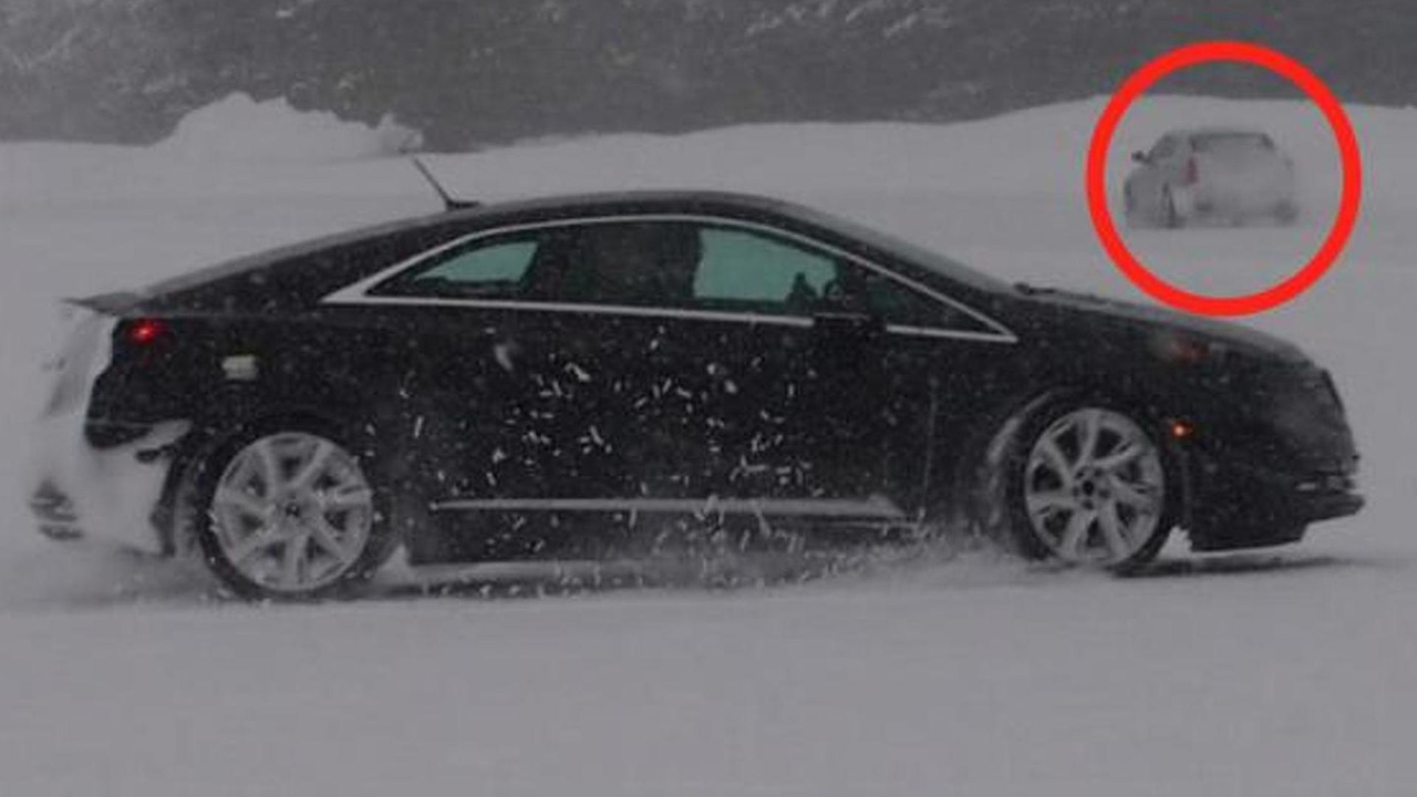 2014 Cadillac CTS (in the background)