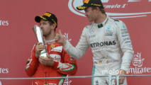 Sebastian Vettel, Ferrari with Nico Rosberg, Mercedes AMG F1