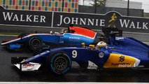 Marcus Ericsson, Sauber C35 and Pascal Wehrlein, Manor Racing MRT05 battle for position