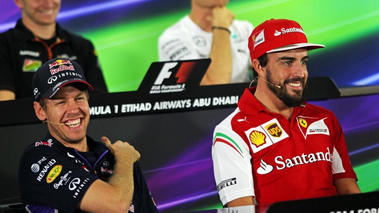 Sebastian Vettel (GER) with Fernando Alonso (ESP) in the FIA Press Conference, 20.11.2014, Abu Dhabi Grand Prix, Yas Marina Circuit / XPB