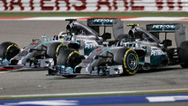 Lewis Hamilton and Nico Rosberg battle during 2014 Bahrain Grand Prix