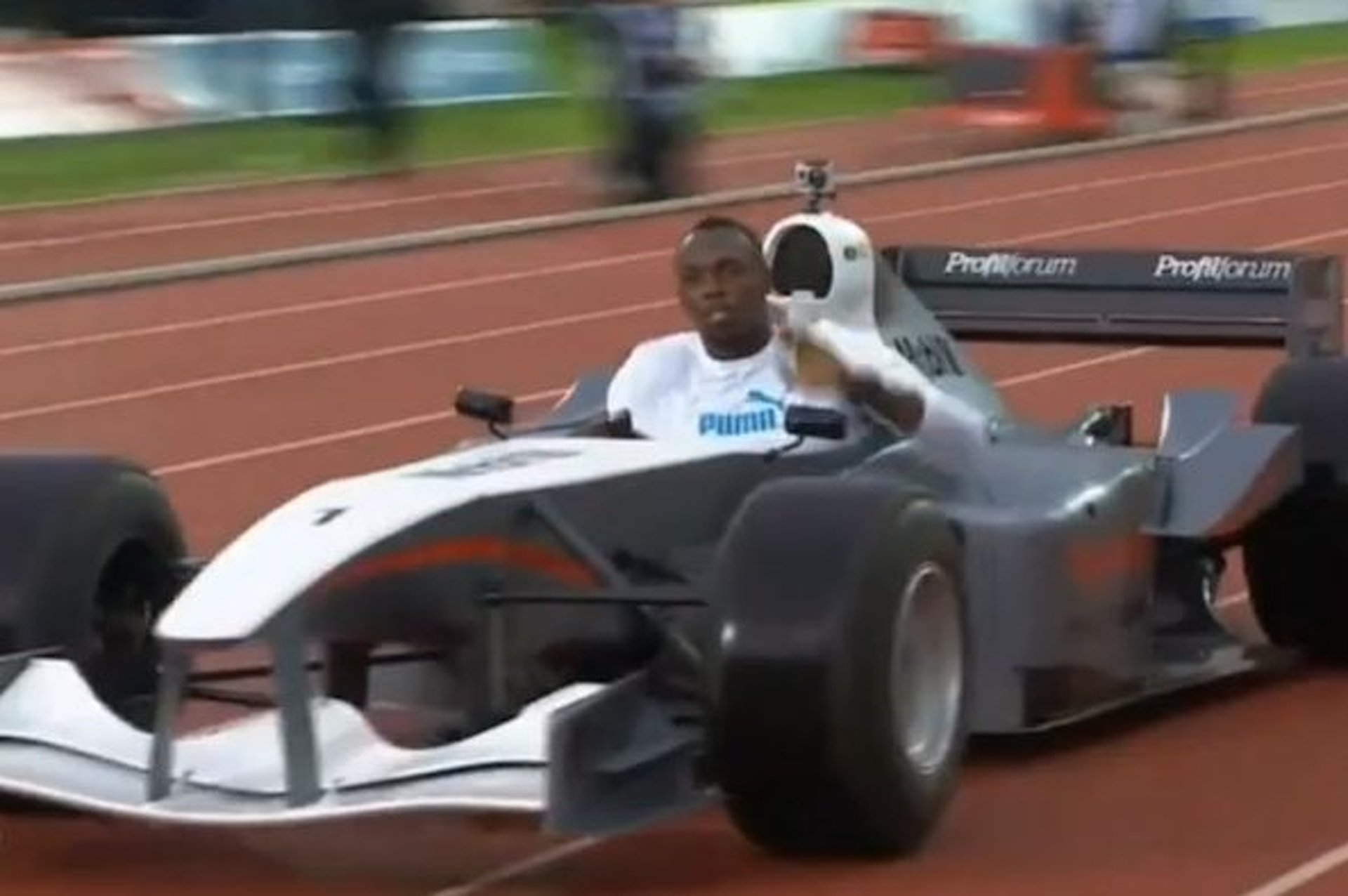 Usain Bolt Drives Around a Track in an F1 Car [video]