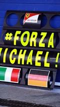 A Ferrari pit board showing support for Michael Schumacher