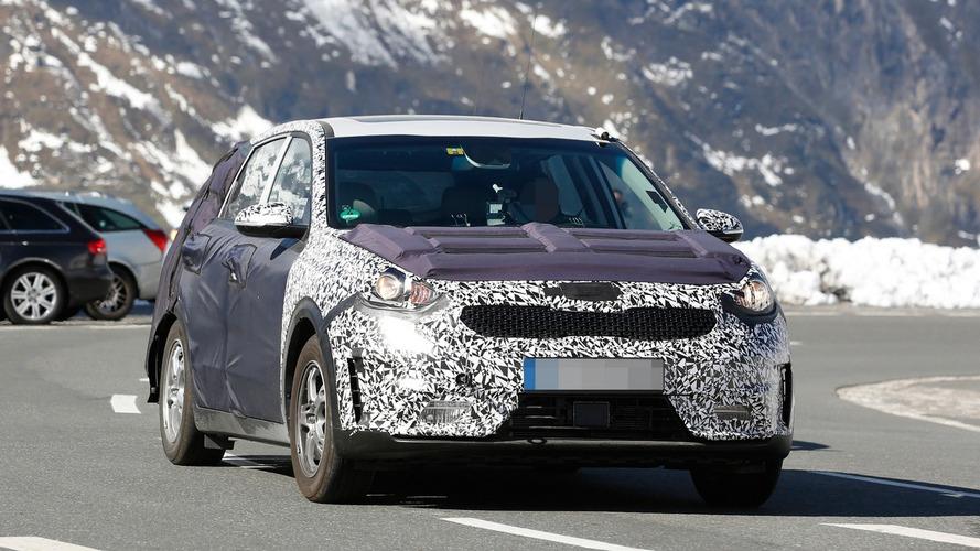 Kia Niro hybrid crossover spied towing a Picanto