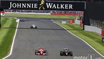Sebastian Vettel, Ferrari SF16-H and Jenson Button, McLaren MP4-31 battle for position