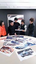 Nissan new global compact car design process - sketches on table