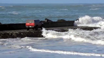 Nissan pickup driver rescued from waves