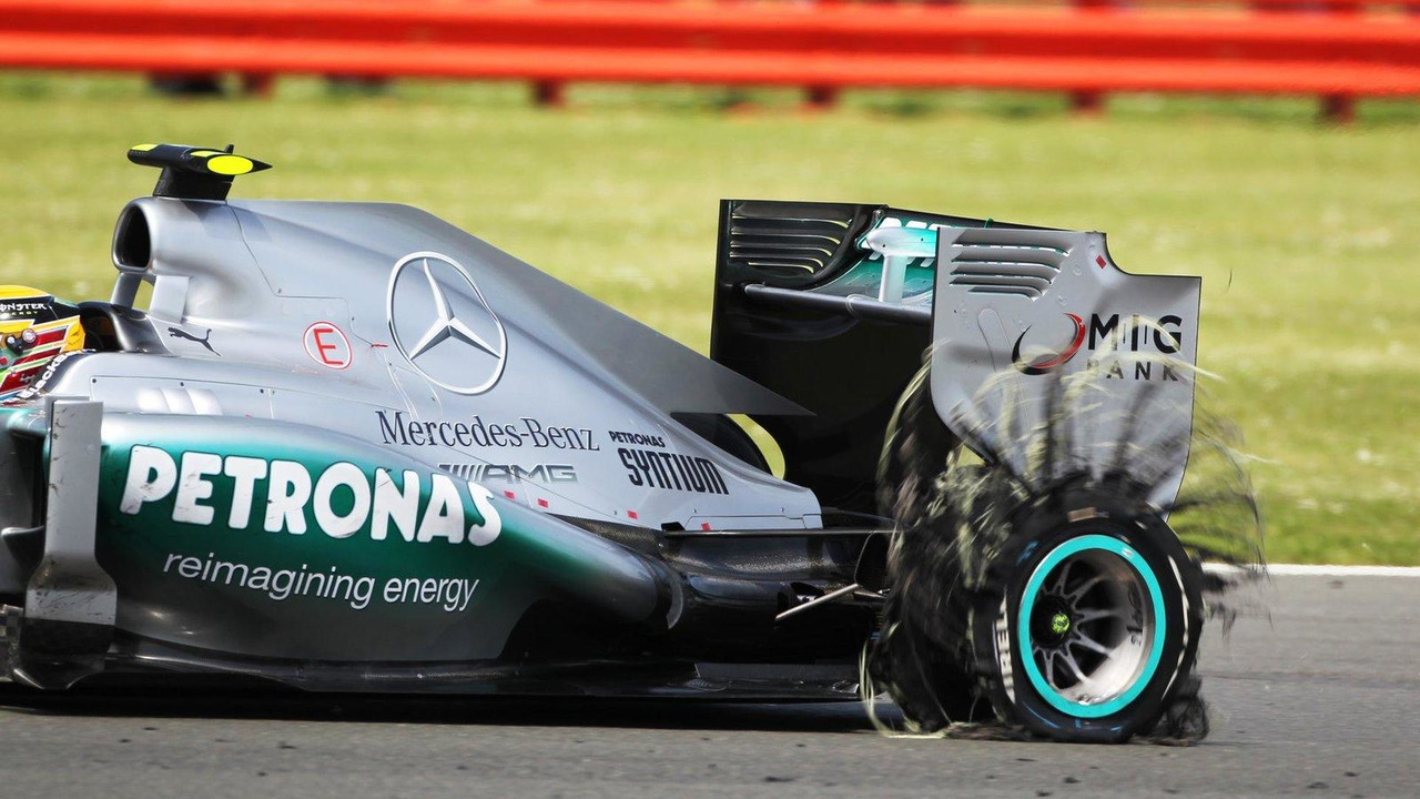 Lewis Hamilton at British Grand Prix returning to pits with punctured rear Pirelli tire 30.06.2013
