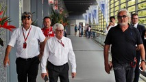 Pasquale Lattuneddu of the FOM with Bernie Ecclestone and Flavio Briatore