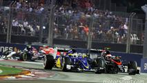 Marcus Ericsson, Sauber C34 and Jenson Button, McLaren MP4-30 battle for position