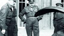 British officers inspect car. Ivan Hirst on left