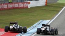 Fernando Alonso, McLaren MP4-31 and Sergio Perez, Sahara Force India F1 VJM09 battle for position