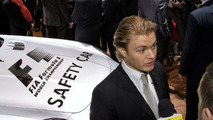 Nico Rosberg talking to the media next to the Mercedes SLS AMG F1 Safety Car at Geneva Motor Show