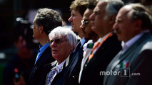 Bernie Ecclestone, as the grid observes the national anthem