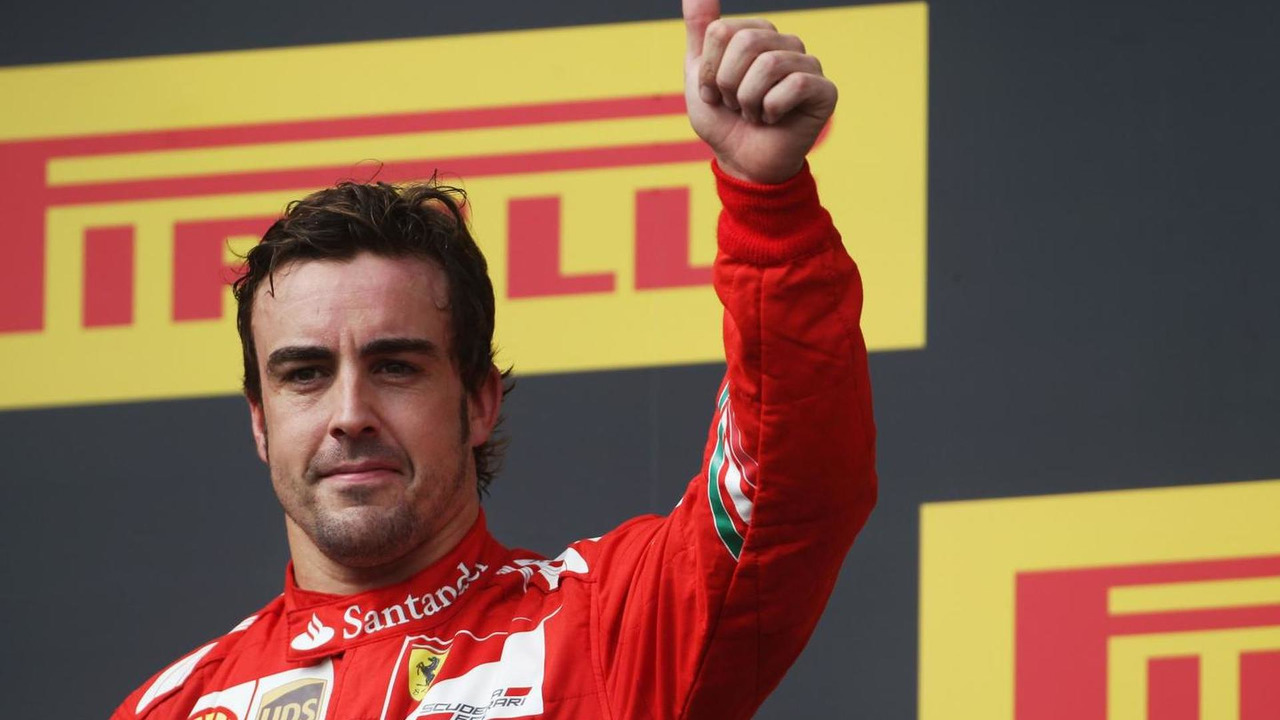Fernando Alonso (ESP) celebrates his second position on the podium, 27.07.2014, Hungarian Grand Prix, Budapest / XPB