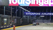 A marshal runs along the circuit as Nico Rosberg, Mercedes AMG F1 W07 Hybrid leads at the restart