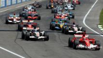 Start- Michael Schumacher takes the lead